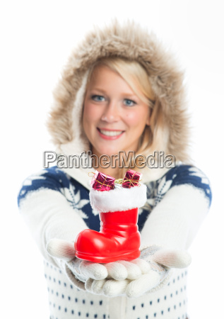 woman holding santa claus boots