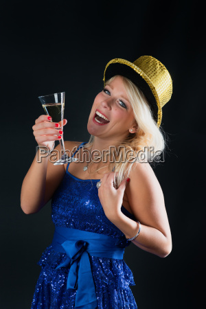 blonde woman celebrating new years eve