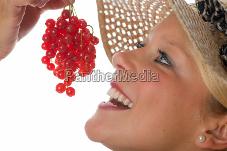 blond woman with red currants