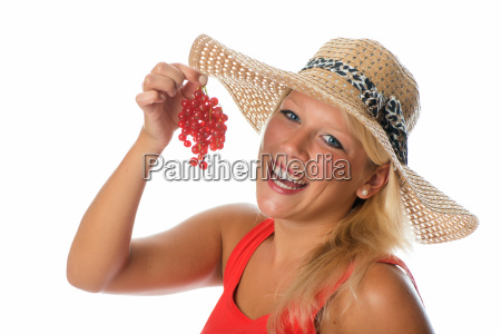 blonde woman with redcurrants