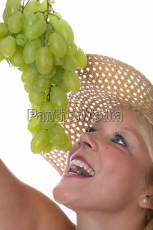 blond woman with grapes