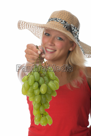 blonde woman with grapes