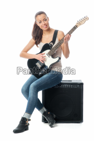 young girl with electric guitar and