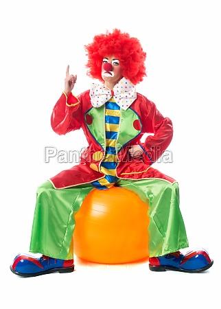 clown points his finger