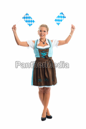 bavarian girl waving flags