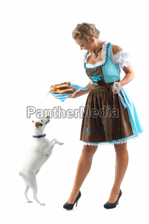 bavarian woman with pretzels and dog