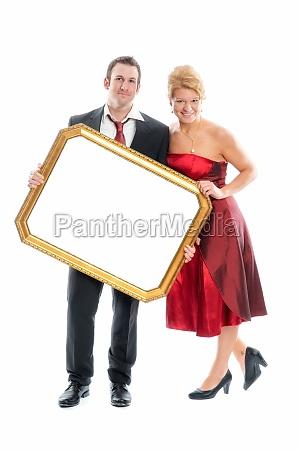 enamoured couple holding frame