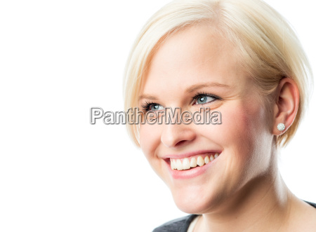 blond young girl smiles