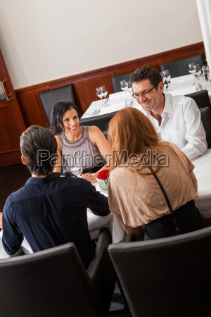 young couple group in a restaurant