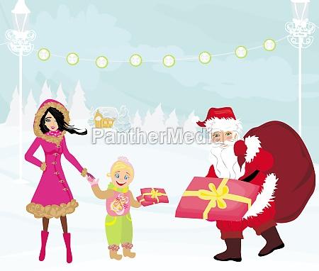 santa claus verteilt geschenke