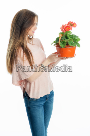 young girl with potted plant
