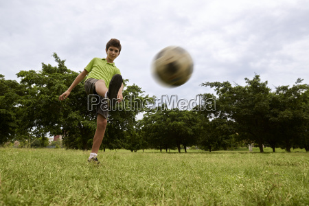 kid playing football and soccer game