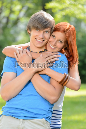young loving couple hugging in sunny