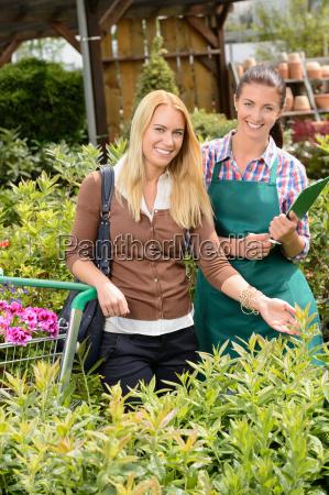 garden center worker and woman customer