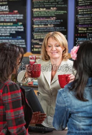 woman serving drinks