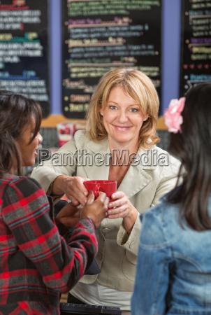 cashier serving drinks