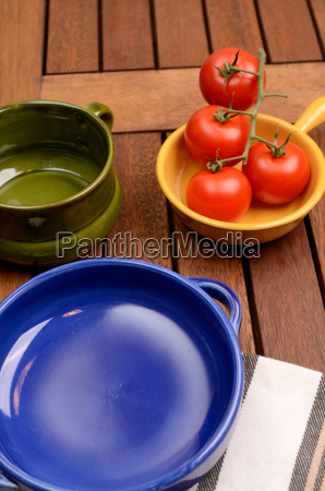 empty plates on a wooden table