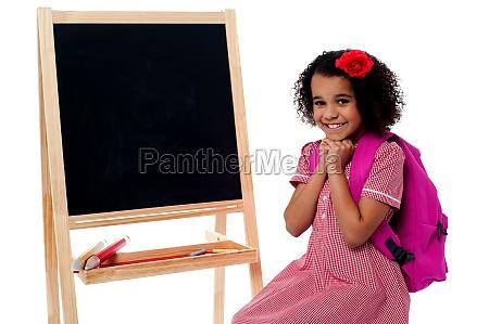 pretty girl sitting near blank chalk