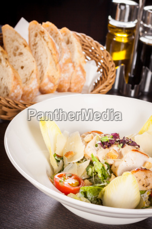 fresh delicious caesarsalad with grilled chicken