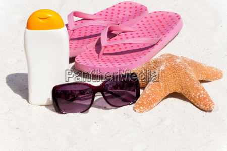 sunscreen and flip flops on the