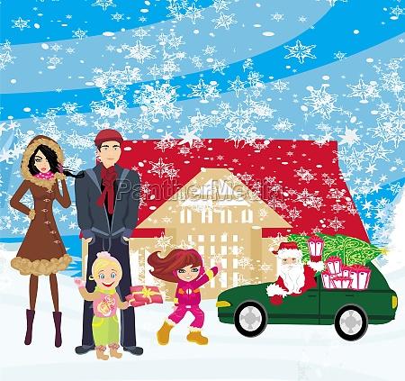 familie wartet auf geschenke vom weihnachtsmann