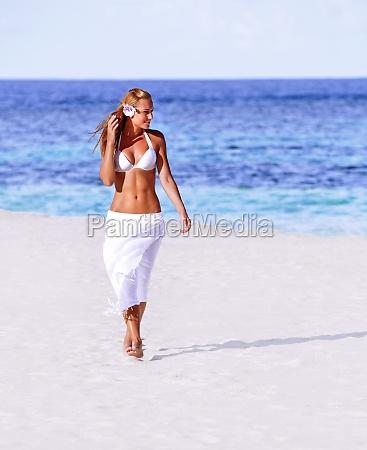 hot girl walking on the beach