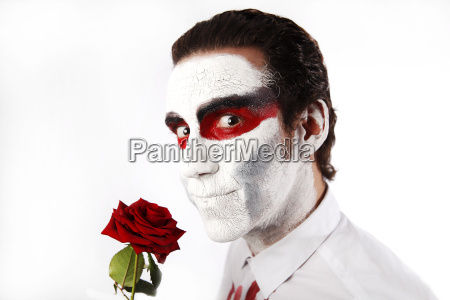 man with white mascara and red