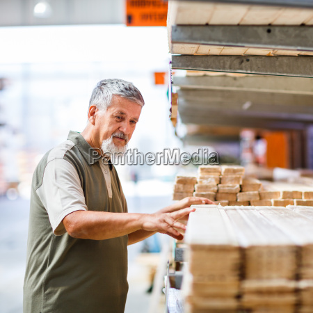 man choosing and buying