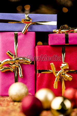 four solid gift boxes and festive