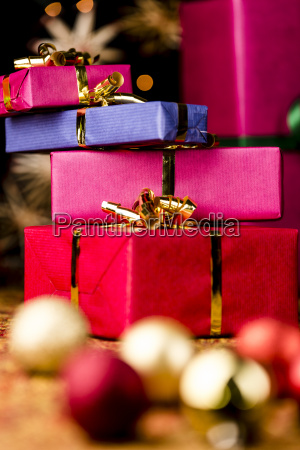 stack of four presents and spheres
