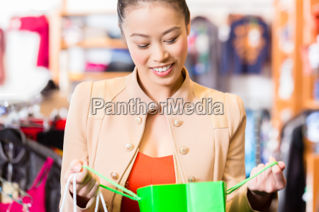 woman with shopping bags in the
