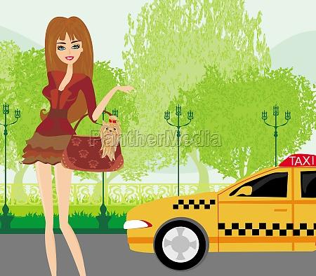 elegante frau wartet auf ein taxi
