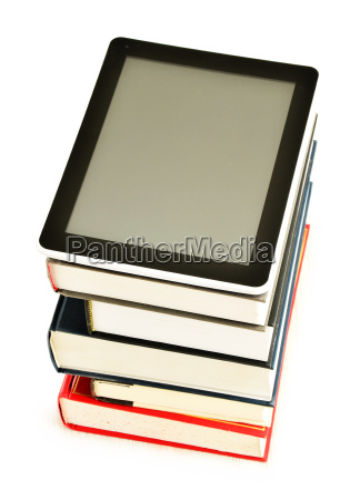 composition with books and tablet computer