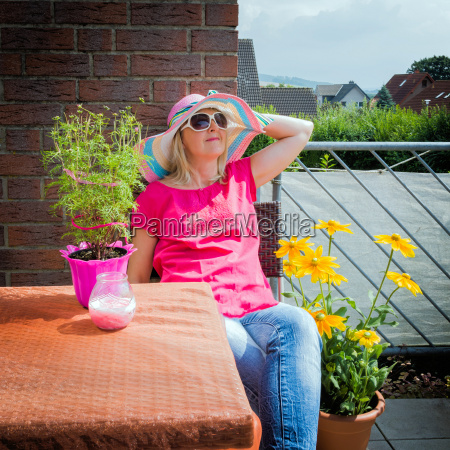 woman recovers on the balcony in