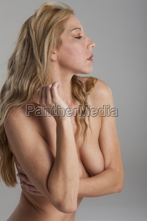 blond naked woman on gray background