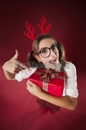 shocked nerdy woman pointing at christmas