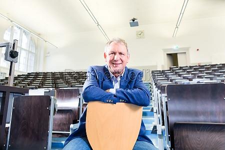 university professor in lecture hall