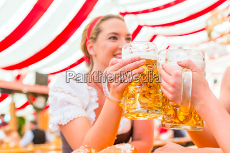 friends drinking beer at oktoberfest