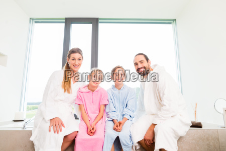 family sitting together at bath