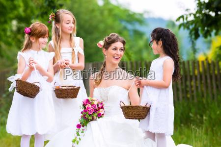 bride in wedding dress with flower