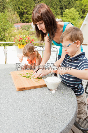 mother prepares food with her children