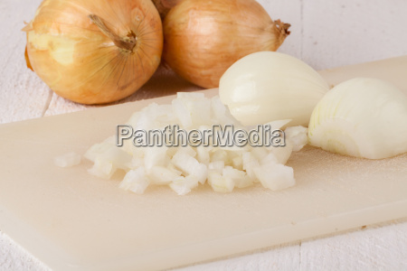peeled white and red onions and
