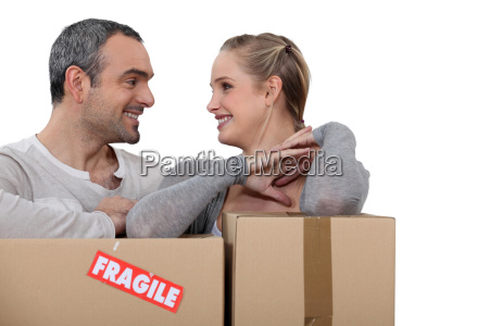 couple stood with cardboard boxes