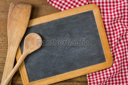 blackboard with wooden spoons on a