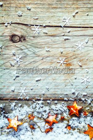 girlande der weihnachtssterne mit schneeflocken