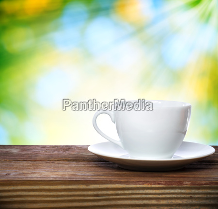 coffee cup on shiny green background