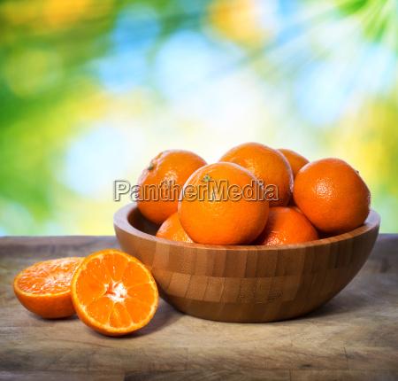 tangerines in wooden bowl