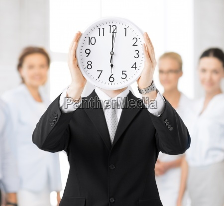 man with wall clock