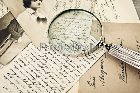 old magnifying glass and letters