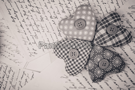 fabric hearts and old handwritten letters